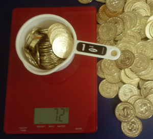 Toy coins worked well for the demo since they don't fit neatly into the cup