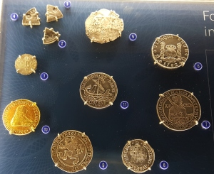 Display depicting the different coins in use in colonial America prior to our independence.